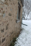 hand parged barn wall